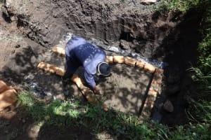 The Water Project: Eshikhugula Community, Shaban Opuka Spring -  Laying The Foundation