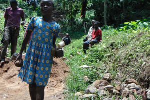 The Water Project: Shamiloli Community, Kwasasala Spring -  Girl Carries Stones To The Construction Site