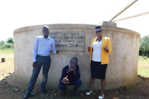 The Water Project: Sipande Secondary School -  Kelvin Isaack And Jacklyne At The Back Of The Tank