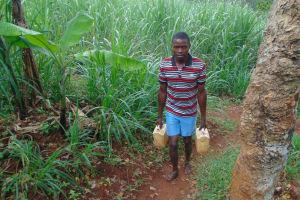 The Water Project: Namarambi Community, Iddi Spring -  Carrying Water