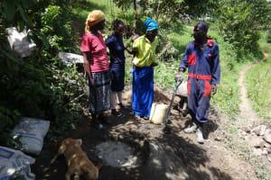 The Water Project: Eshikhugula Community, Shaban Opuka Spring -  Community Members Talk With Artisan