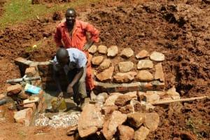 The Water Project: Mutao Community, Kenya Spring -  Artisans Enjoying Work