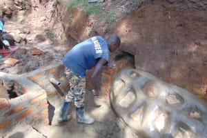 The Water Project: Buhayi Community, Nasichundukha Spring -  Smoothing The Rub Wall
