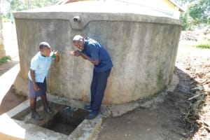 The Water Project: Muyere Secondary School -  Field Officer Wilson Kipchoge With Student
