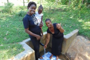 The Water Project: Mbande Community, Handa Spring -  Thumbs Up For Flowing Water