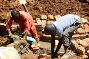 The Water Project: Mutao Community, Kenya Spring -  Adding The Discharge Pipe