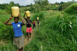 The Water Project: Emurumba Community, Makokha Spring -  Children Carrying Water Home
