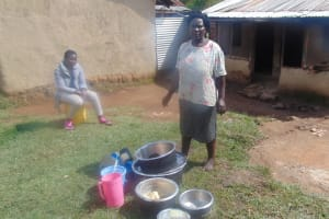 The Water Project: Mukangu Community, Metah Spring -  Woman Prepares To Wash Dishes
