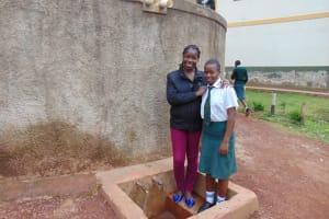 The Water Project: Kwirenyi Secondary School -  Field Officer Christine With Nicorine Shitamu