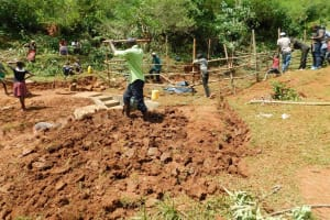The Water Project: Mutao Community, Kenya Spring -  Clearing The Area Digging Cut Off Drainage