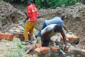 The Water Project: Shamiloli Community, Kwasasala Spring -  Pipe Setting