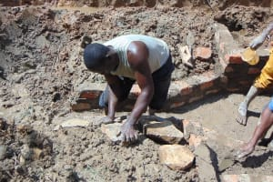 The Water Project: Shamiloli Community, Kwasasala Spring -  Setting Stones For The Rub Wall