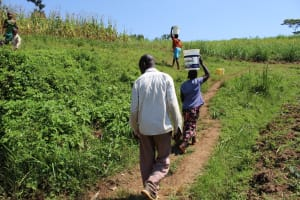 The Water Project: Kalenda A Community, Webo Simali Spring -  Carrying Water Home