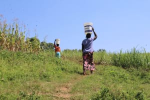 The Water Project: Kalenda A Community, Webo Simali Spring -  Carrying Water