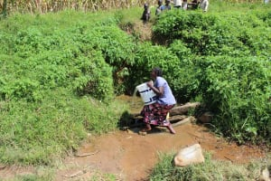 The Water Project: Kalenda A Community, Webo Simali Spring -  Lifting Bucket Filled With Water