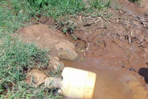 The Water Project: Musiachi Community, Mutuli Spring -  Container Fills With Water
