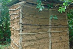 The Water Project: Mubinga Community, Mulutondo Spring -  A Latrine With Mud Walls