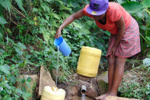 The Water Project: Mubinga Community, Mulutondo Spring -  Fetching Water