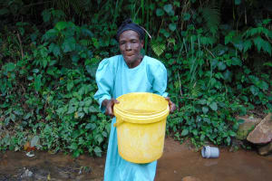 The Water Project: Mubinga Community, Mulutondo Spring -  Lifting Bucket Filled With Water