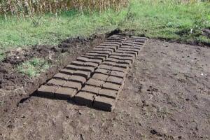 The Water Project: Maondo Community, Ambundo Spring -  Bricks Curing
