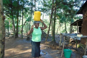 The Water Project: Maondo Community, Ambundo Spring -  Carrying Water