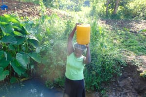 The Water Project: Maondo Community, Ambundo Spring -  Hauling Container With Water