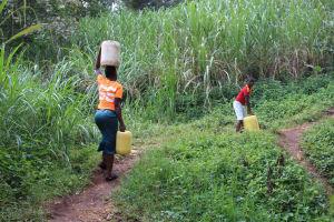 The Water Project: Imbinga Community, Imbinga Spring -  Carrying Water Home