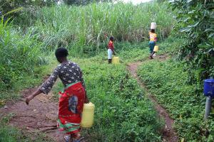 The Water Project: Imbinga Community, Imbinga Spring -  Carrying Water
