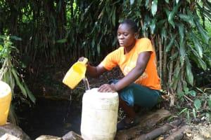 The Water Project: Imbinga Community, Imbinga Spring -  Fetching Water