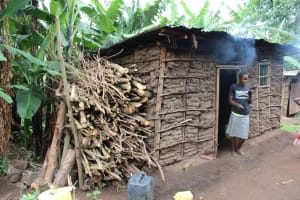 The Water Project: Imbinga Community, Imbinga Spring -  Ms Salano In Front Of Her Kitchen
