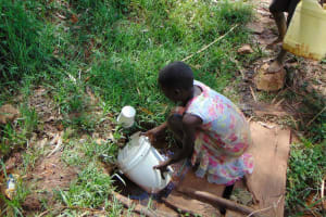 The Water Project: Jivovoli Community, Magumba Spring -  Filling Up Container With Water At The Spring