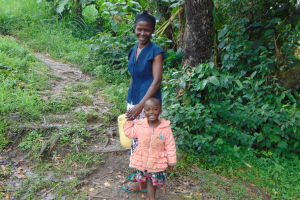 The Water Project: Buyangu Community, Mukhola Spring -  Mother And Her Daughter