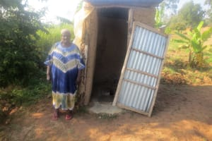 The Water Project: Emmachembe Community, Magina Spring -  A Community Member At Her Latrine