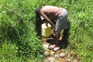 The Water Project: Emmachembe Community, Magina Spring -  Fetching Water At The Spring