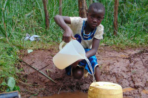 The Water Project: Masuveni Community, Masuveni Spring -  Filling Container With Water