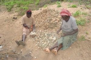 The Water Project: Kangalu Community -  Sorting Rocks