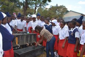 The Water Project: AIC Kyome Girls' Secondary School -  Handwashing Demonstration