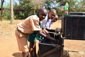 The Water Project: Matiliku Primary School -  Students Use Handwashing Station