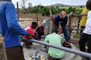 The Water Project: Kikube Nyabubale Community -  Installing The Pump