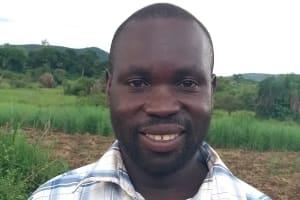 The Water Project: Kikube Nyabubale Community -  Mr Godfrey Asiimwe