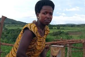 The Water Project: Kikube Nyabubale Community -  Mrs Grace Rukara Pumps The Well