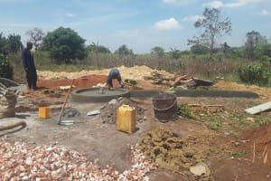 The Water Project: Kikube Nyabubale Community -  Pad Construction