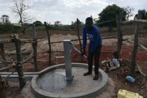 The Water Project: Kikube Nyabubale Community -  Pumping Water At The Well