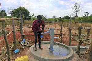 The Water Project: Kikube Nyabubale Community -  Water Flowing