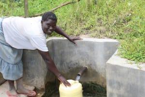The Water Project: Ewamakhumbi Community, Yanga Spring -  Hellen Nelima Fetches Water