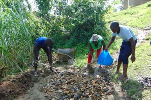 The Water Project: Buyangu Community, Osundwa Spring -  Mixing Concrete