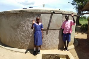 The Water Project: Makuchi Primary School -  Linda Mulati With Moses Murunga At The Tank