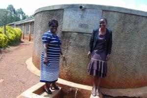 The Water Project: Shitaho Community School -  Head Teacher Mrs Jane Lodeki With Field Officer Rose Serete At The Rain Tank