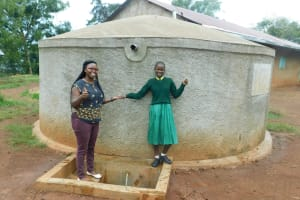 The Water Project: Imbale Primary School -  Field Officer Jacklyne Chelagat With Student Eunice Mmboga