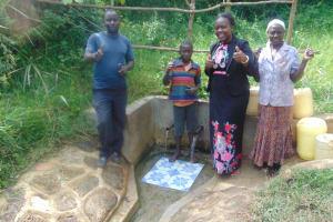 The Water Project: Luvambo Community, Tindi Spring -  Water Committee Secretary Tom Mukonye Matayo Shivonje Field Officer Karen Maruti Joyce Mutachi Water Commitee Member